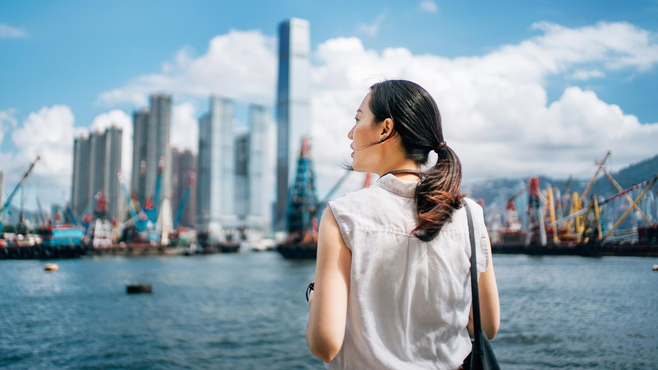 businesswoman looking away toward city and harbour; HSBC International Services Life abroad page